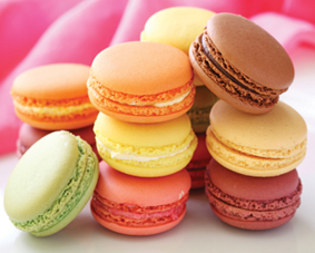 Commonly mistaken for tiny Play-Doh cheeseburgers, macaroons are an edible dessert typically made without the former's borax and petroleum additives. Confirm with your baker before sampling.
